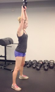 girl weight training with kettle bell